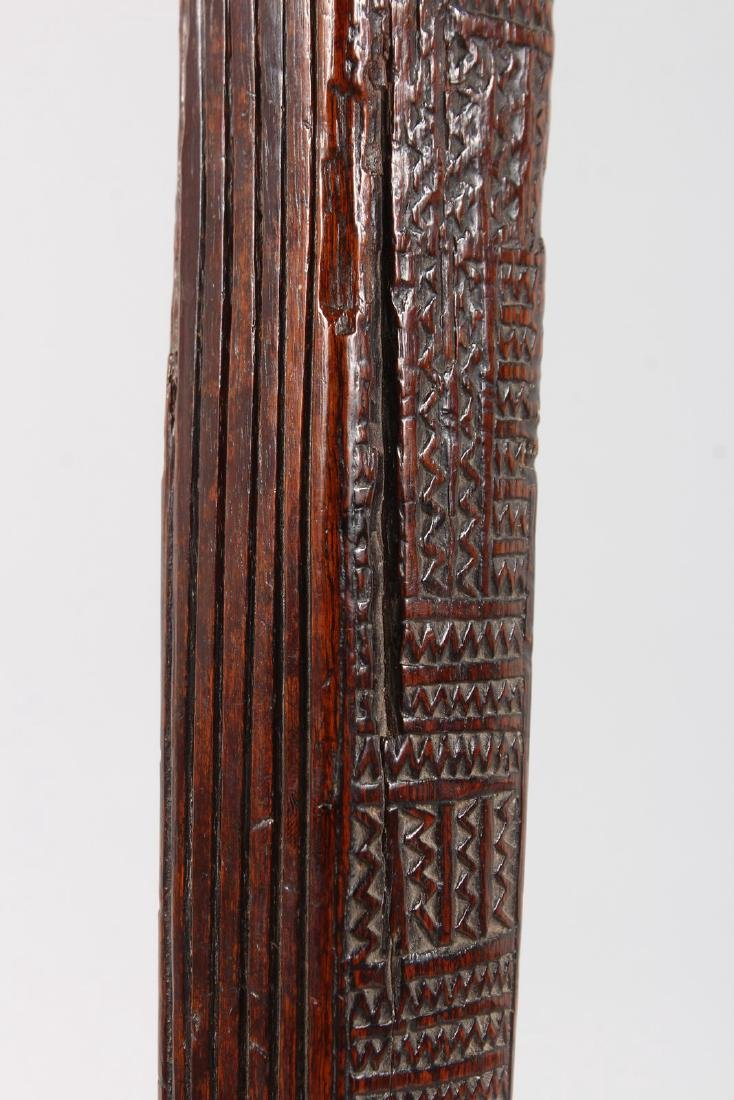 A RARE GILBERT ISLANDS CARVED WOOD CLOTH BEATER, four - 3