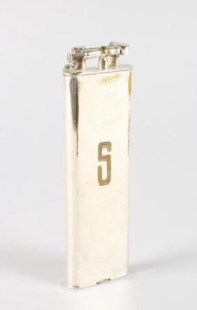 A LONG DUNHILL TABLE LIGHTER, stamped DUNHILL UNIQUE.