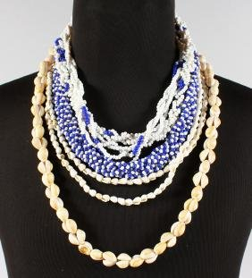 A SHELL NECKLACE and FOUR OTHER NECKLACES.