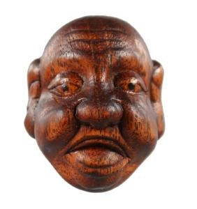 A CHINESE CARVED WOOD NETSUKE, Mask.