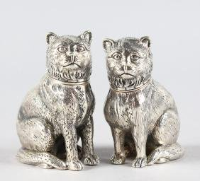 A PAIR OF SOLID SILVER NOVELTY PUG DOG SALT AND