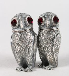 A GOOD PAIR OF WHITE METAL OWL SALT AND PEPPERS.