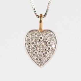A GOOD SMALL DIAMOND HEART SHAPED PENDANT on a chain.