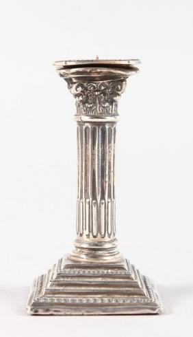 A CORINTHIAN COLUMN SILVER CANDLESTICK.  7cms high.