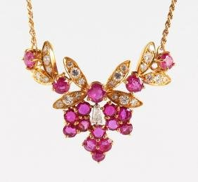 AN 18CT YELLOW GOLD, RUBY AND DIAMOND SET FLORAL