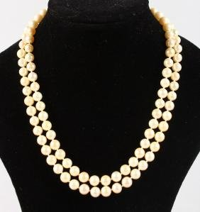 A GOLD PEARL NECKLACE and PAIR OF EAR CLIPS.
