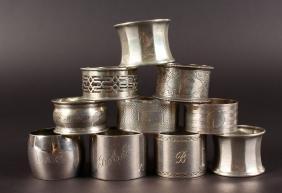 TEN VARIOUS SERVIETTE RINGS, engraved, pierced and