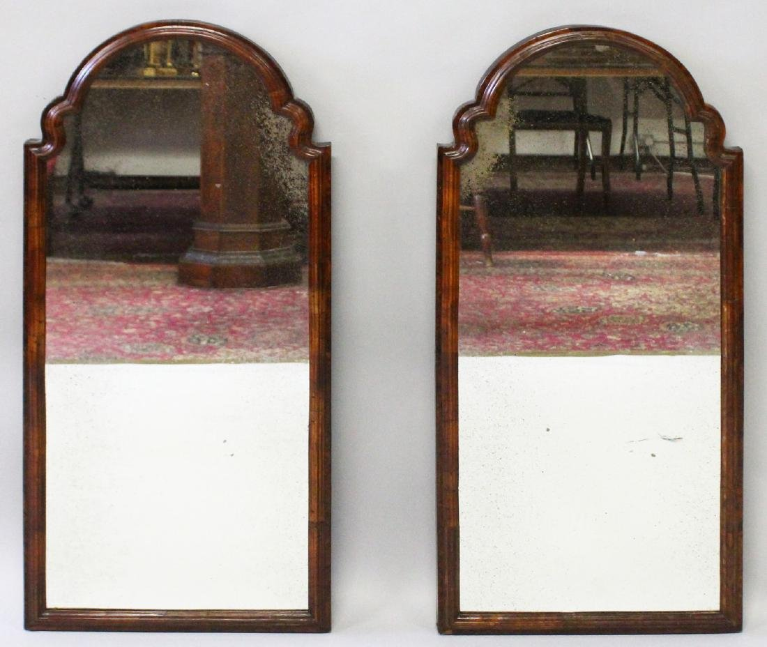 A PAIR OF QUEEN ANNE STYLE WALNUT ARCH TOP MIRRORS
