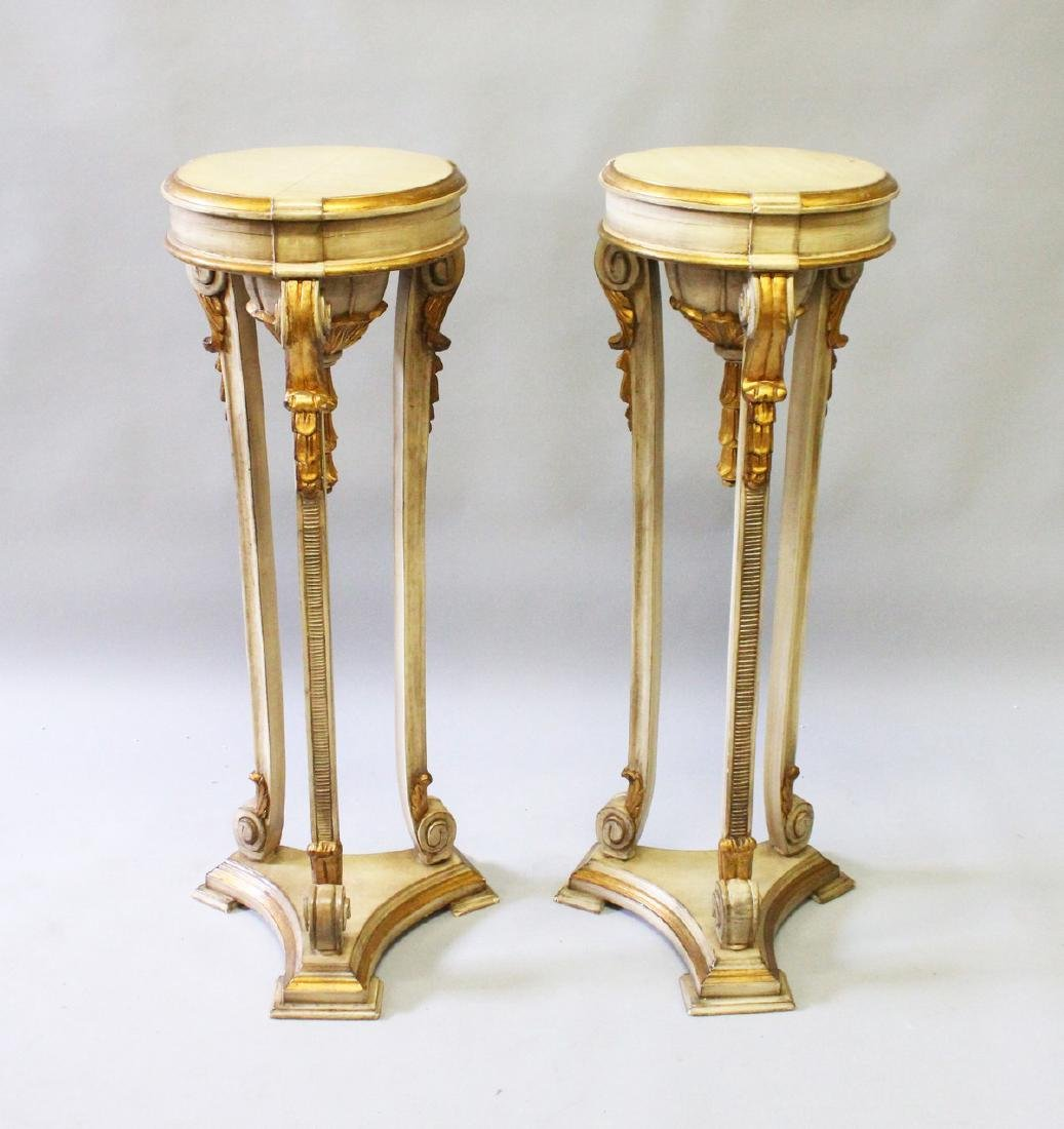 A PAIR OF 19th CENTURY CREAM PAINTED CIRCULAR TOP STAND