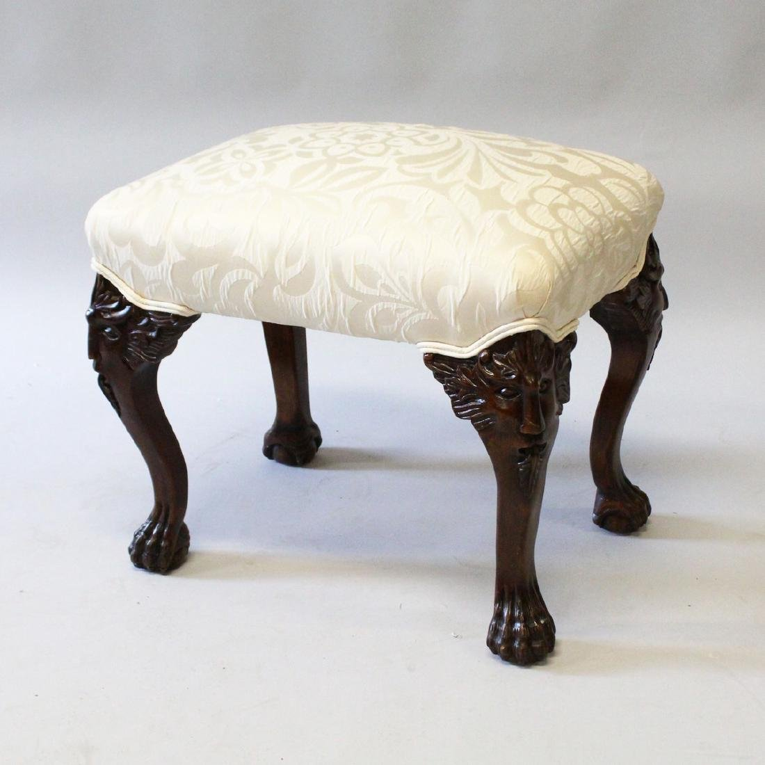 A CHIPPENDALE STYLE MAHOGANY STOOL with padded top