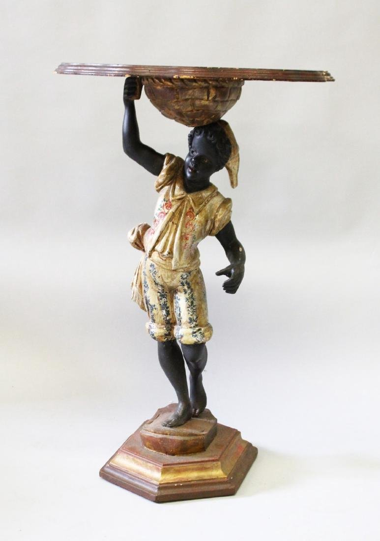 A PAIR OF 19th CENTURY BLACKAMOOR TABLES with shaped