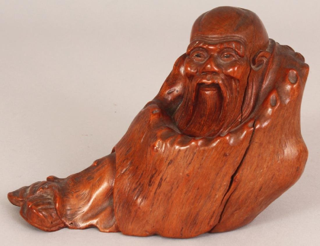 A GOOD QUALITY 19TH CARVED ROOTWOOD FIGURE OF A