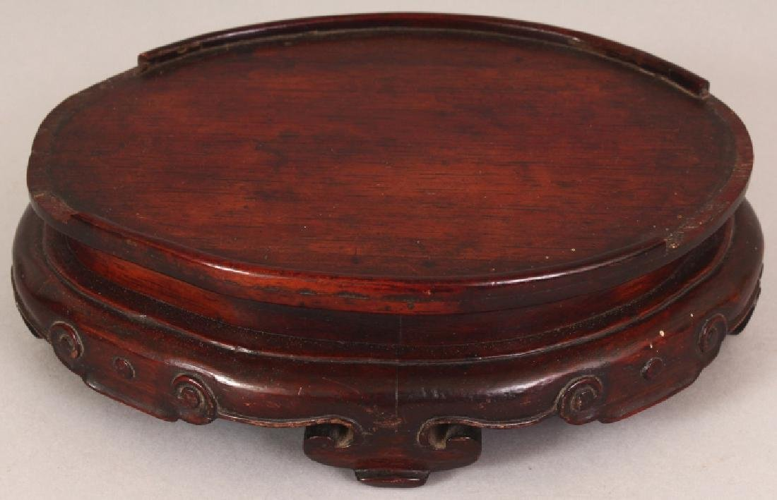 A 19TH CENTURY CHINESE OVAL CARVED HARDWOOD STAND, with