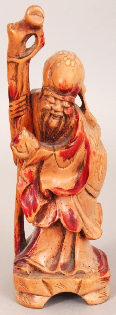 A 19TH/20TH CENTURY CARVED & STAINED WOOD FIGURE OF