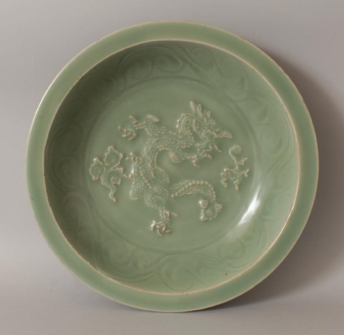 A LARGE MING STYLE LONGQUAN MOULDED CELADON DISH, the