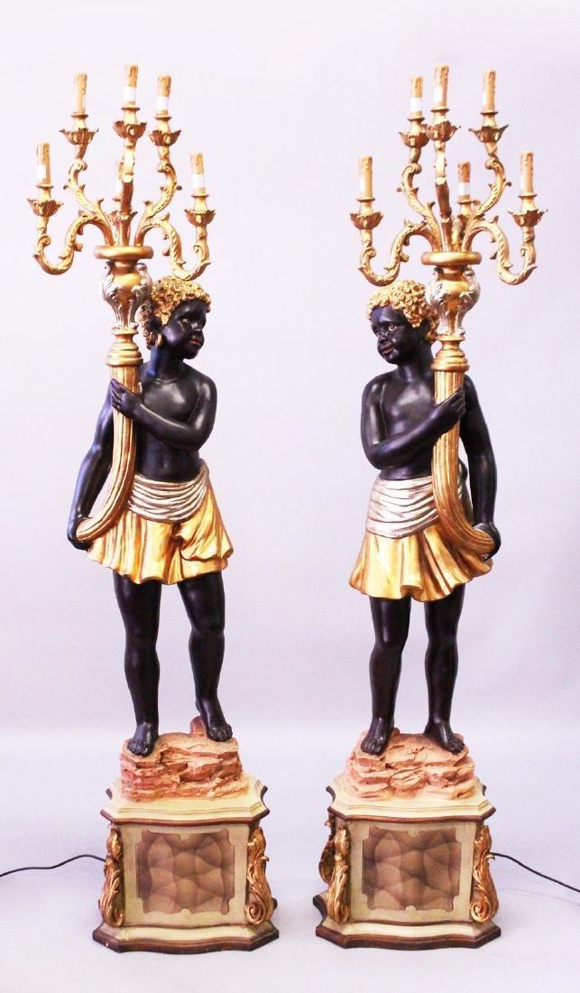 A LARGE PAIR OF BLACKAMOOR STANDING CANDELABRA, each
