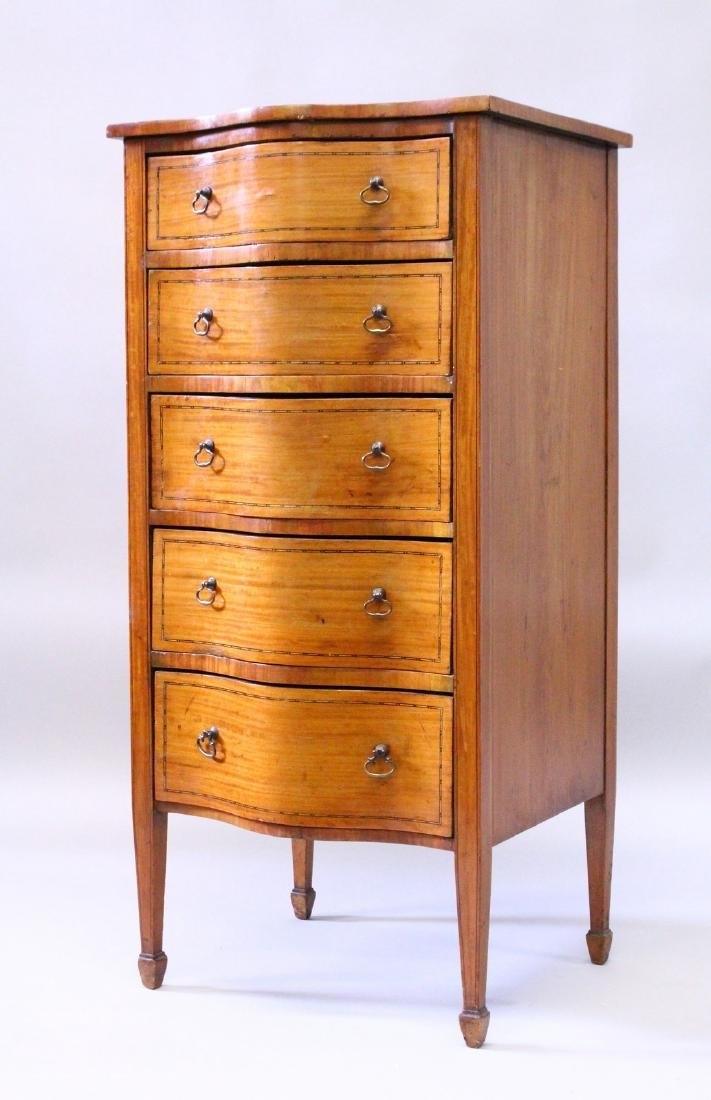 A LATE 19TH CENTURY SATINWOOD SERPENTINE TALL CHEST,