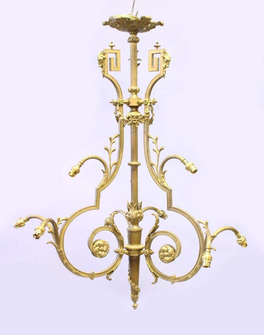 A FRENCH STYLE ORMOLU NINE LIGHT CHANDELIER, 20TH