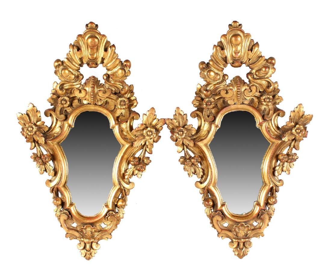 A PAIR OF ITALIAN SHAPED AND CARVED GILTWOOD MIRRORS
