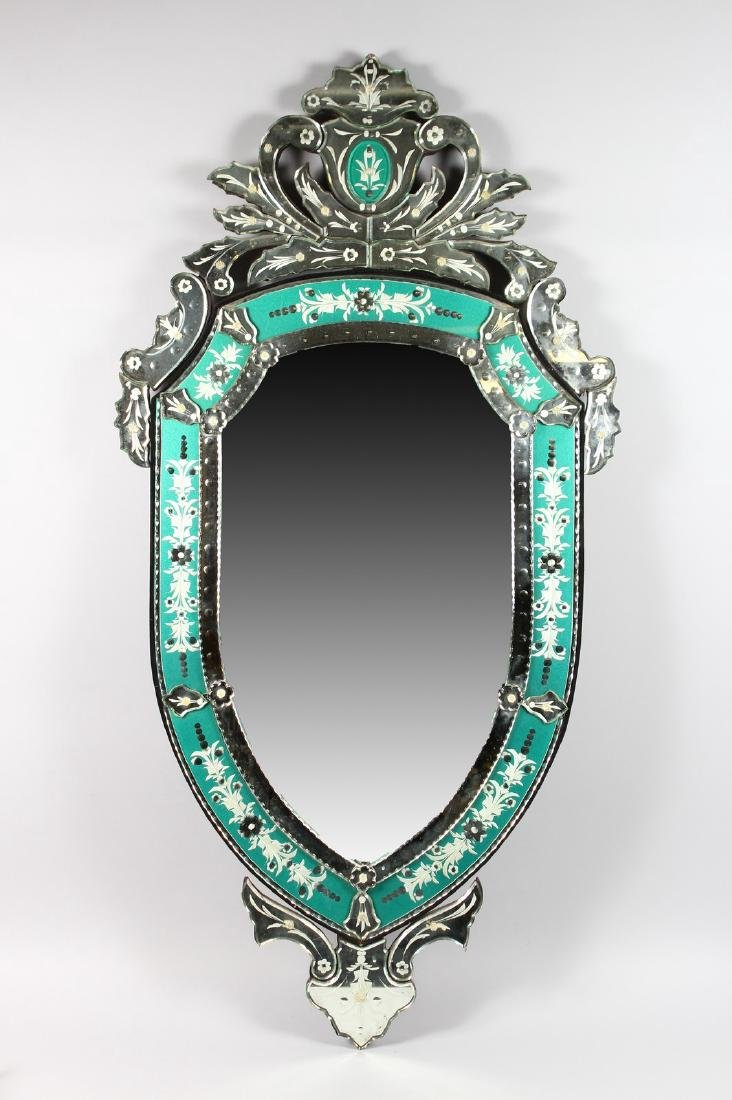 A LARGE VENETIAN ETCHED SHAPED MIRROR with shaped
