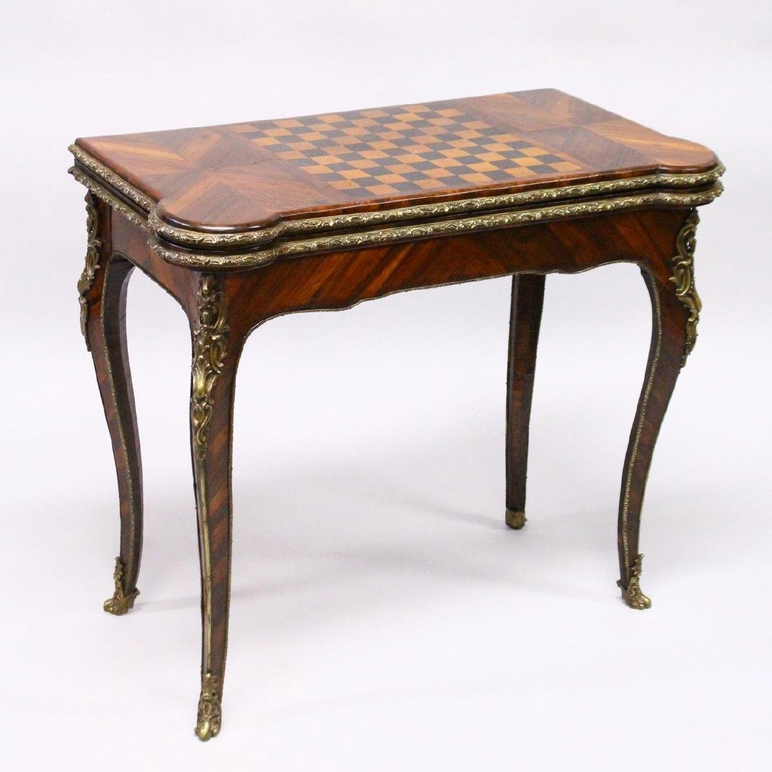 A GOOD GEORGE II GAMES TABLE, the folding top with