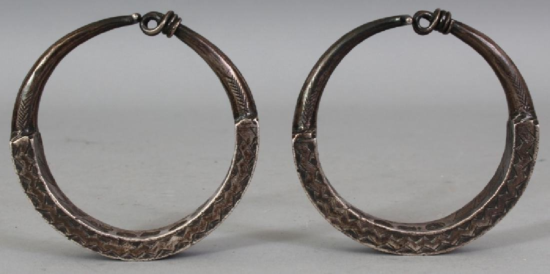 AN UNUSUAL PAIR OF INDO-PERSIAN SILVER-METAL BRACELETS,