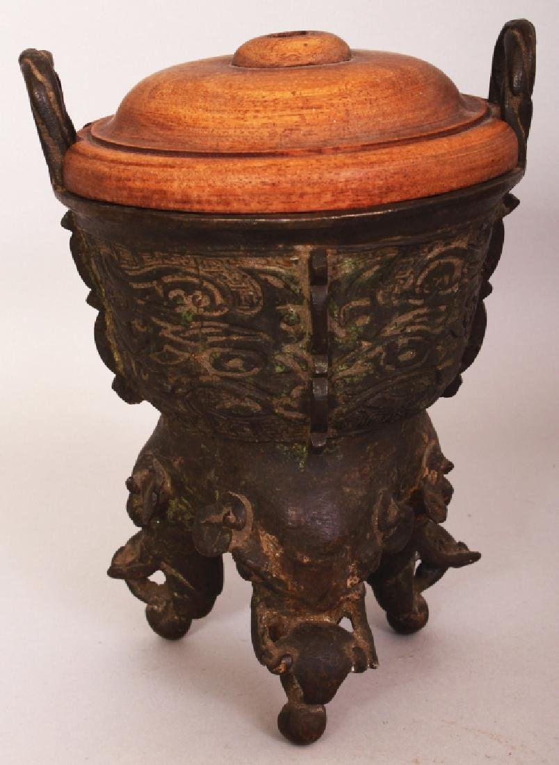 A CHINESE BRONZE ELEPHANT-FOOT TRIPOD CENSER, together