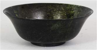 A CHINESE TRANSLUCENT JADE LIKE BOWL, with an everted
