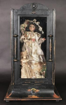 A 19th Century French Cased Automaton, A Doll In A