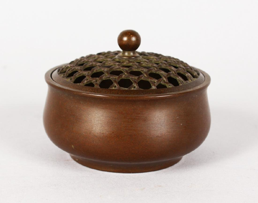 A SMALL CHINESE BRONZE CIRCULAR CENSER with pierced