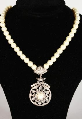 A Swarovski Pendant With Pearls In Original Box.