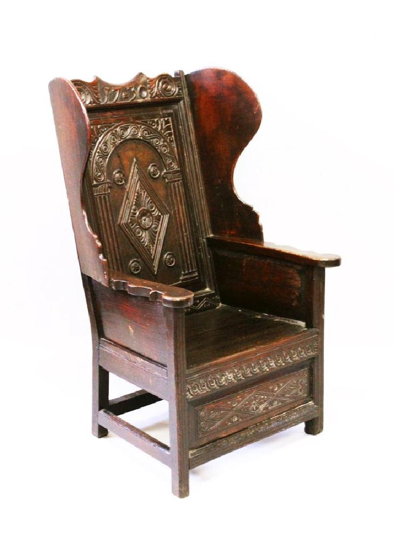 A RARE EARLY 18TH CENTURY OAK LAMBING CHAIR, with