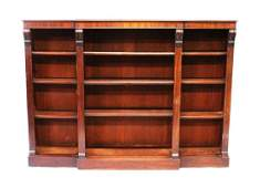 A 19TH CENTURY MAHOGANY BREAKFRONT OPEN BOOKCASE with