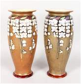 A PAIR OF ROYAL DOULTON STONEWARE VASES painted by