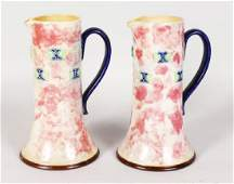 A PAIR OF ROYAL DOULTON STONEWARE JUGS with blue