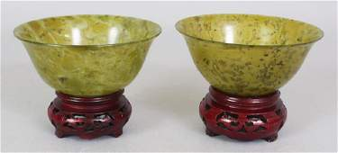 TWO 20TH CENTURY CHINESE MOTTLED GREEN JADE-LIKE BOWLS,