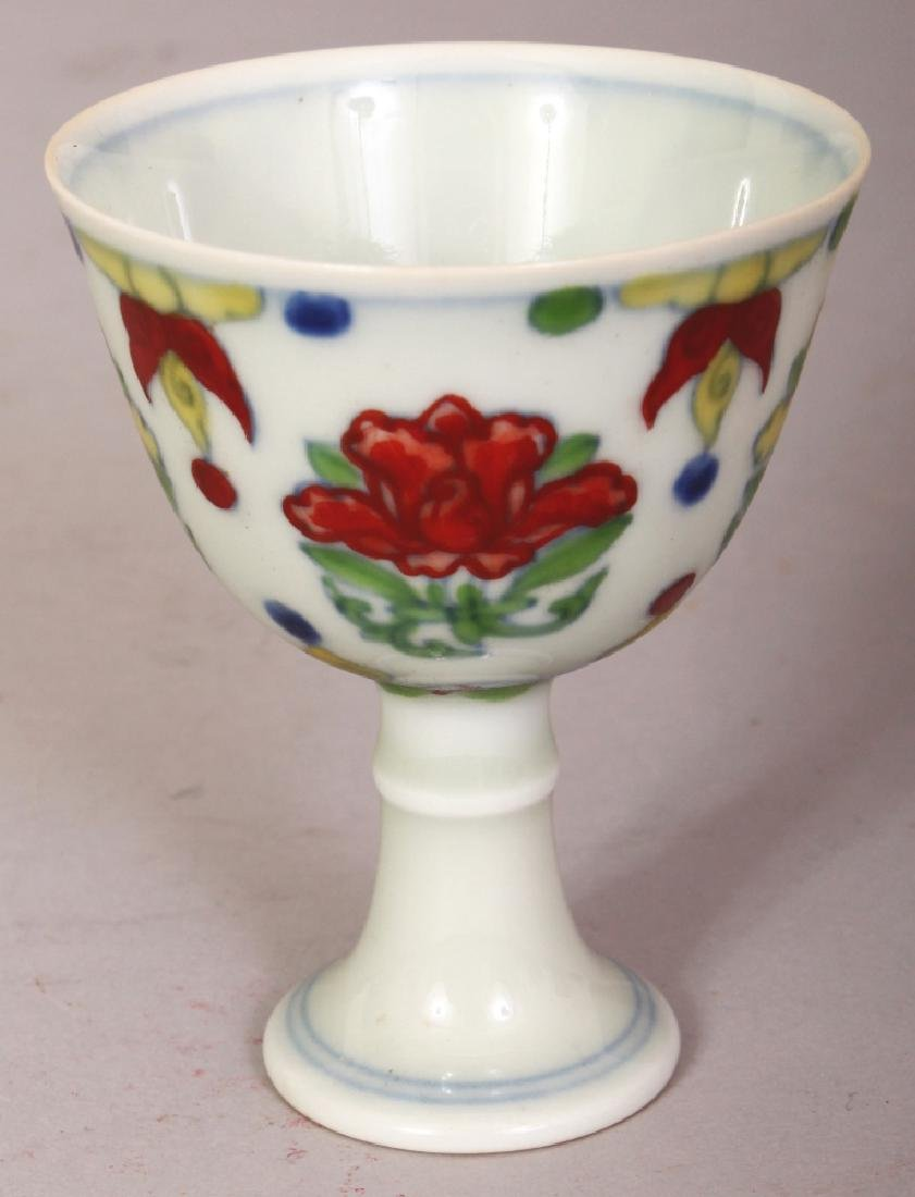 A CHINESE DOUCAI PORCELAIN STEM CUP, the inside of the