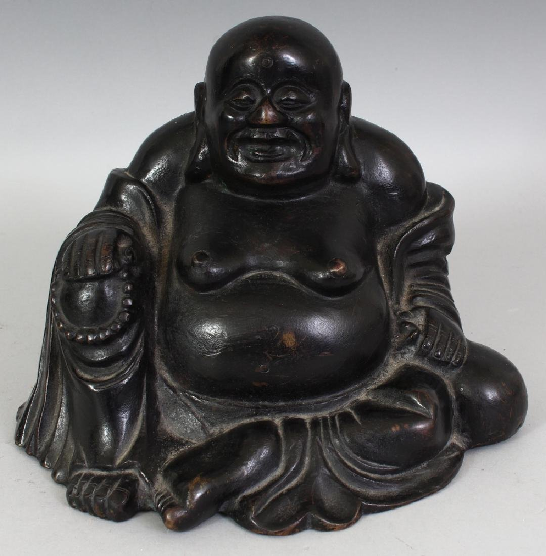 A CHINESE QING DYNASTY BRONZE FIGURE OF BUDAI, seated