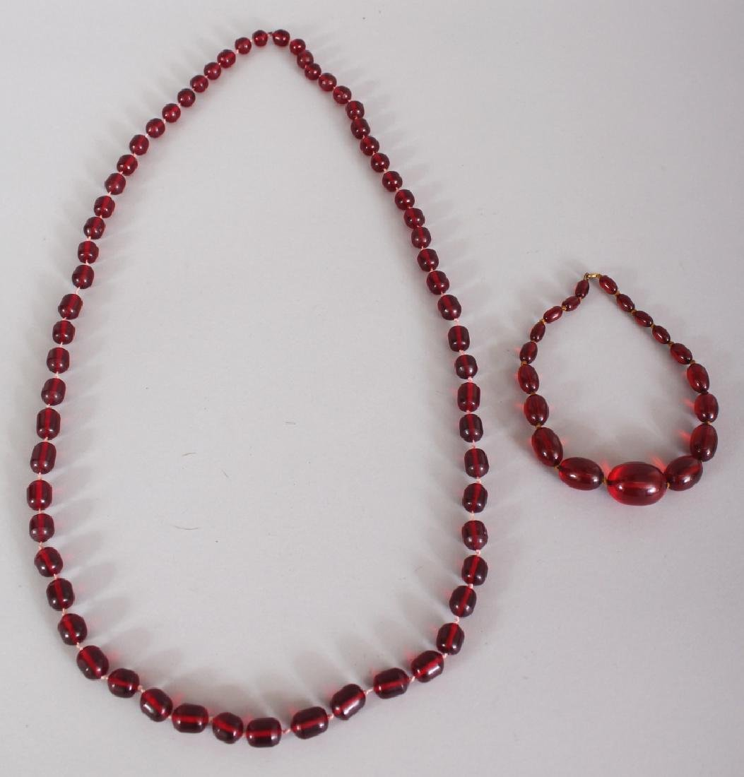 TWO RECONSTITUTED 'CHERRY AMBER' NECKLACES, weighing