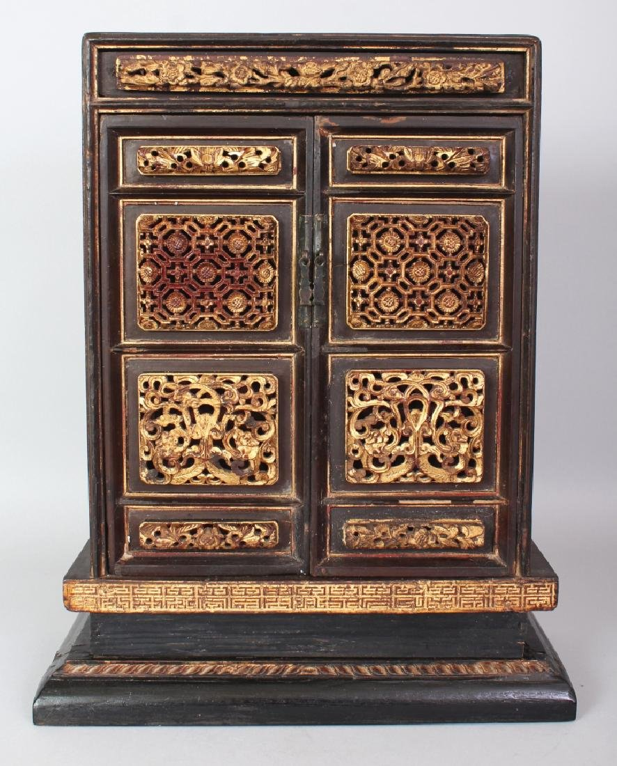 A 19TH/20TH CENTURY CHINESE GILT WOOD CABINET, the two