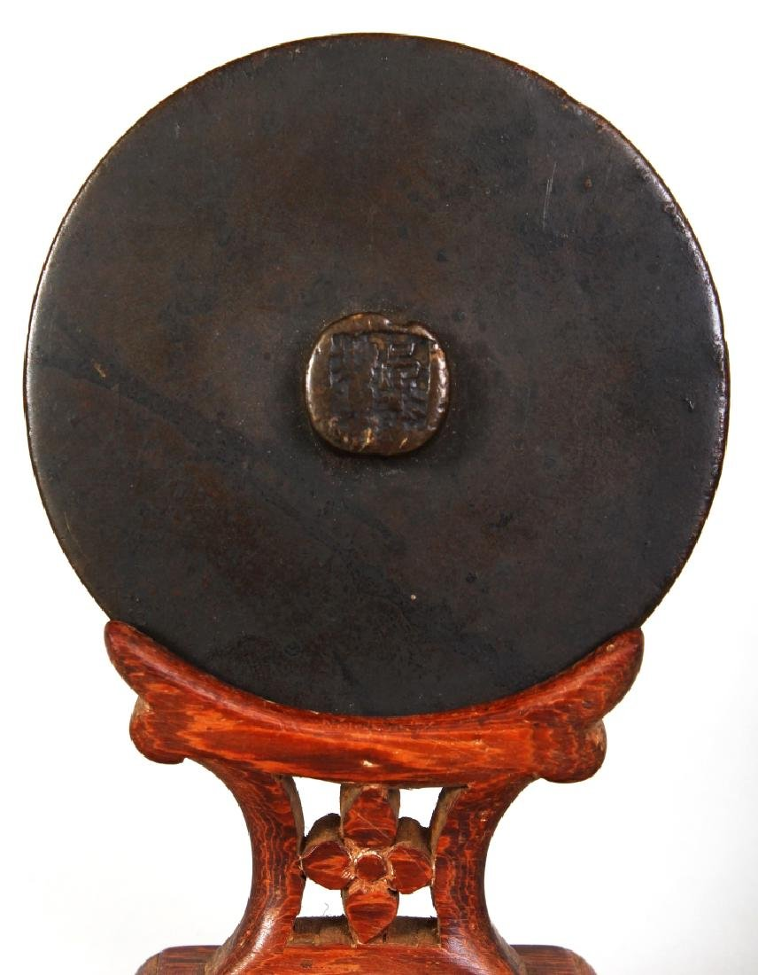A SMALL CHINESE BRONZE MIRROR, possibly early, together - 2
