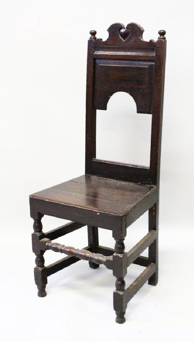 A 17TH CENTURY OAK SINGLE CHAIR with solid seat.