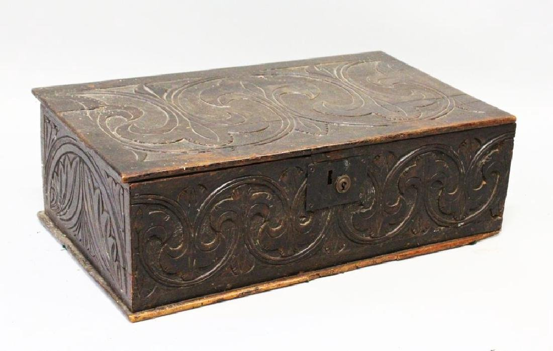 A 17TH CENTURY CARVED OAK BIBLE BOX, carved with