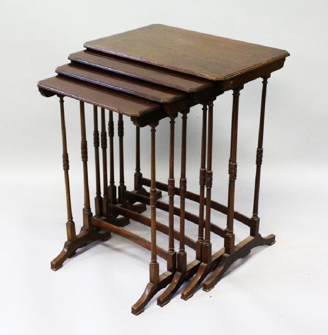 AN EDWARDIAN MAHOGANY NEST OF FOR TABLES on turned