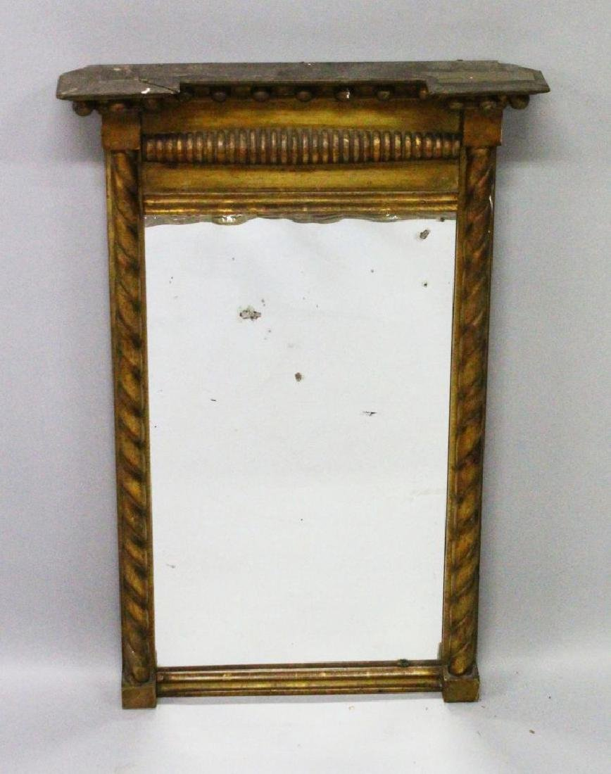 A REGENCY CARVED AND GILDED UPRIGHT PIER MIRROR with