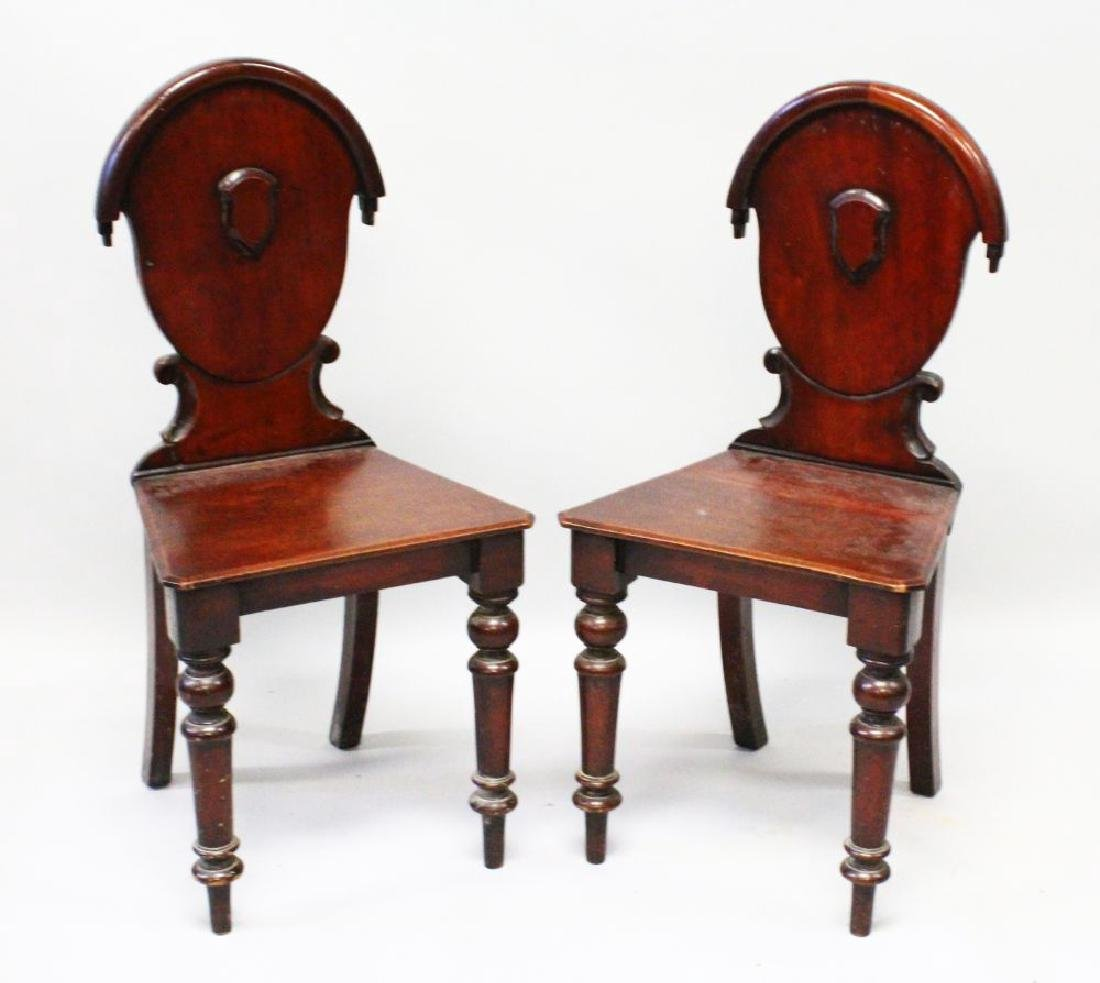 A PAIR OF VICTORIAN MAHOGANY HALL CHAIRS with oval