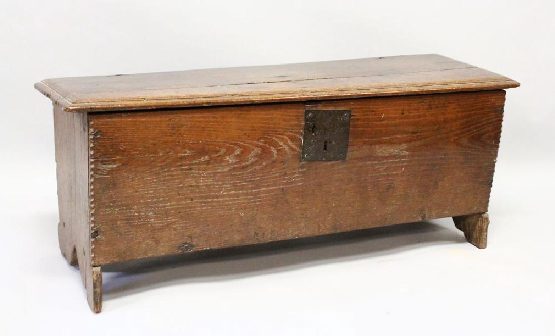 A 17TH CENTURY OAK LONG COFFER with plain plank