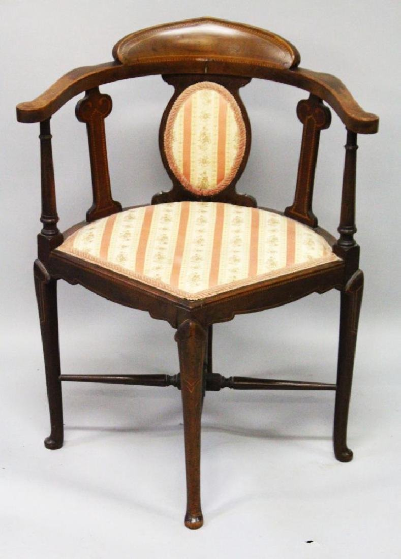 AN EDWARDIAN MAHOGANY INLAID CORNER CHAIR with padded
