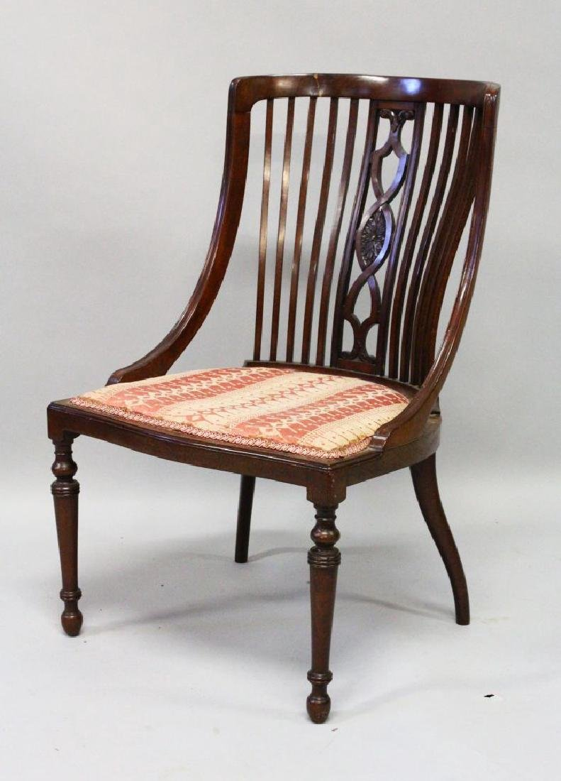A VICTORIAN MAHOANY NURSING CHAIR with railed back and