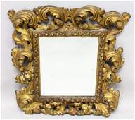 A 19TH CENTURY ITALIAN CARVED GILTWOOD MIRROR with